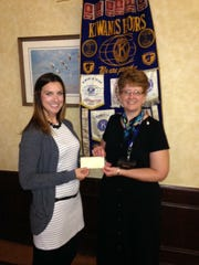 "Tiffany Heim, left, president of the Fond du Lac Noon Kiwanis from 2015 to 2016, presents Shelley Tidemann with a check for the ""Just In Time Parenting"" newsletter program."
