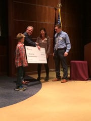 Kevin Steiner presents a check from the MACC Fund to