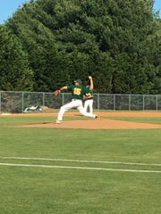 Queen Anne's hurler Aaron Rovenolt throws a pitch in