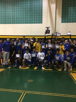 The North Brunswick volleyball team celebrates after winning the GMCT on May 20.