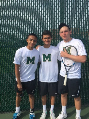Montgomery High School's singles players, Ishaan Ravichander (to the left), Vishnu Joshi and Mark Fridman pose in the early season.