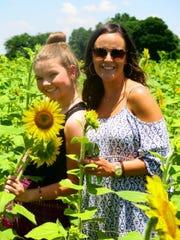 Mary-Elizabathe Nordberg and Alexandra Zurenko in sunflower