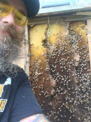 Drew Ruegg, owner of Drunk Monk Apiaries and Honey