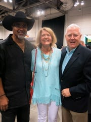 Former State Rep. Roy Burrell, Terri and Mike Madison at Cooking Classic