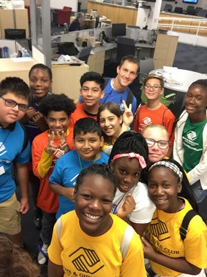 A group of students from the Boys & Girls Club take a selfie for National Selfie Day inside the Naples Daily News Wednesday, June 21, 2017. Today is also the first day of summer.