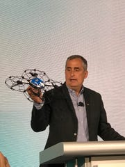Intel CEO Brian Krzanich holds up a drone during an