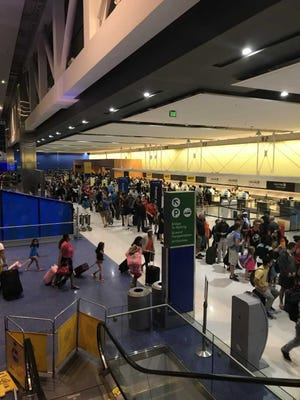 Long lines were reported in the North Terminal at Detroit Metro Airport following a power outage.