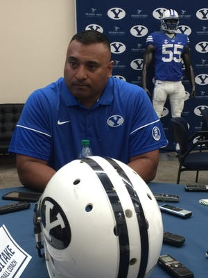 BYU head football coach Kalani Sitake talks with reporters during BYU's annual football media day on Friday.