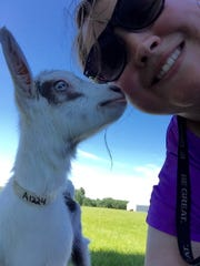 """Sarah Razner posing with a goat in a """"gelfie"""" following Goat Yoga at LaClare Farms on June 17."""