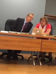 New Lebanon School Board Superintendent Arthur Abrom and Secretary Mary Harrell discuss the agenda before Monday night's school board meeting.