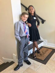 Axton Middlebrook (age 9) and McKenzie Del La Cruz (age 11) served as greeters for the Cox's Open House to honor all subcontractors and volunteers who helped them build their new home on the Isles of Capri.