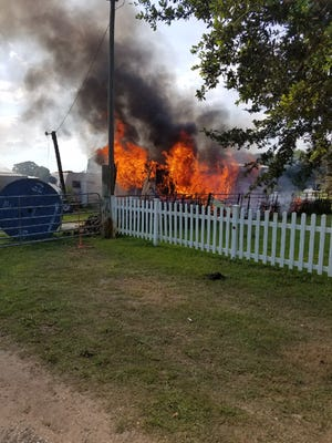 A mobile home in Scott was destroyed in a fire early Monday morning.
