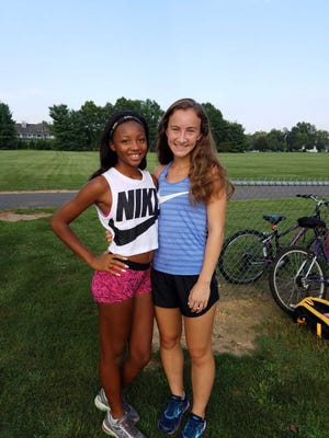 South Brunswick cross country runners Chantel Osley and Nicole Fenske pose after a recent practice.