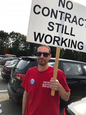 Mike Michels, vice president of the Ramapo Indian Hills teachers' union, at a rally on Sept. 12. Teachers are calling for a new contract.