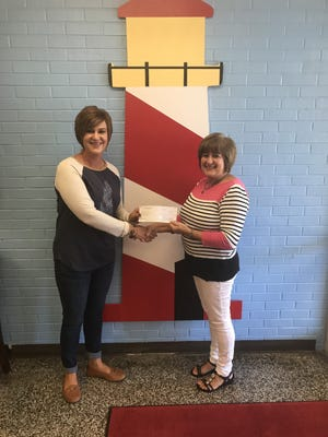 Sturgis Elementary Principal Michelle Hall, at left, is pictured with Kentucky Bike Rally owner Carlene Thomas. Mrs. Thomas presented Sturgis Elementary School with a $1000 check to support The Leader in Me Program Thursday morning.