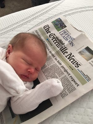 Newborn Harley Allen, photographed with the front page of The Greenville News from the day she was born.