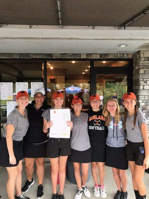 Member of Ashland's Division I sectional championship team: left to right, Leah Metzger, coach Amanda Young, Emma Swain, Anna Watson, Abby Fossaceca, Livia Sponsler and Kira Moore.