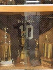 Joe Theismann's jersey in the school's trophy case.