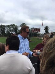 Joe Theismann signs an autograph during South River's game Saturday.