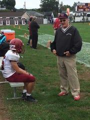 Highland Park coaching legend Joe Policastro talks to a player.