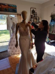 Rhodora Paloma, a local seamstress, putting the finishing