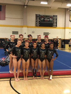 The Bishop Ahr gymnastics team pose after winning the GMC title on Oct. 21.
