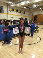 Bishop Ahr junior Ariyana Agarwala poses after her team won the GMC championship and she won the all-around title.