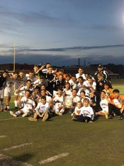 The Monroe boys soccer team poses after winning the GMCT championship on Oct. 28.