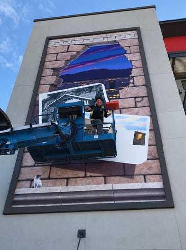 Developers hired Phoenix artist Lucretia Torva to create a mural on the north side of the Alta Fillmore apartment complex, contributing a sense of intrigue to its modern design as well as adding street-level creativity.
