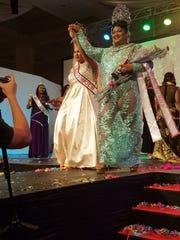 Queens embracing victory!  Left to right:  Sasha Leigh Santos and Maria Delfina Quinata.