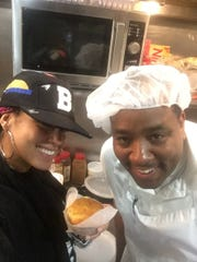 Alicia Keys was a surprise customer Sunday, Nov. 12 at Mr. Tod's Pie Factory in Englewood. Here the 15 time Grammy winner poses with Wilson and a corn muffin.