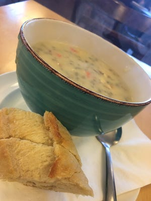 A bowl of creamy chicken wild rice soup, served with a baguette, at Ko-Z's Eats & Sweets in Waite Park.