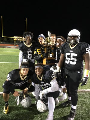 South Brunswick football players celebrate after beating North Brunswick in their annual rivalry game.