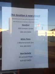 The sign on the door of Buffalo Wild Wings' Port Chester