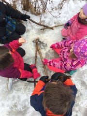 Letting the kids play imaginative games on their winter hike is a great way to keep them engaged.