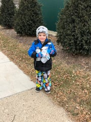 Bentley Scheer, 4, helps clean up the city with his dad, Nathan Scheer. Father and son cloean up parks and playgrounds, downtown streets, and also shovel snow for their neighbors.