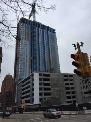 Northwestern Mutual's 7Seventy7 apartment tower is under construction and scheduled to open in June. The apartment tower is built on top of a parking structure.
