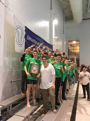 The St. Joseph High School swimmers celebrate after winning their 40th straight GMC title.