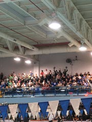 The crowd cheers during the GMC boys swimming championship on Jan. 26