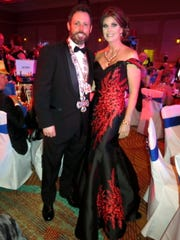 Scott Alexander and wife Angel Alexander, a glamorous gal in a room filled with beautifully dressed gals, were among those partying the night away at des Ambassadeurs-Minden Grand Bal.