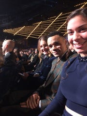Lorna and Tauren Wells and Jaycee Bowers wait to hear the announcement for the contemporary Christian music awards at the Grammys.