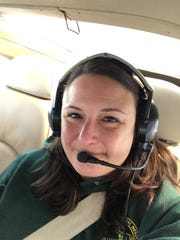 Jennifer Kleitch, a DNR wildlife biologist, is one of the hearty souls with strong stomachs who take to the skies for the state's annual elk survey.