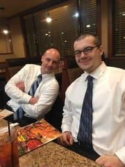 Public defender Beau Blouin, left, eats at Fryn' Pan