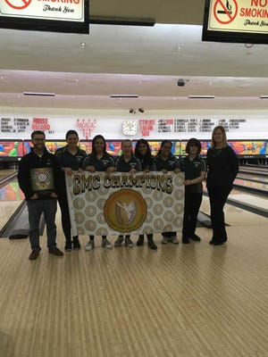 The East Brunswick girls bowling team poses after winning the GMC Tournament on Feb. 6, 2018.