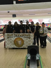 The Monroe Boys bowling team poses after winning the