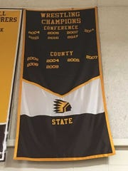 The banner hanging in the Watchung Hills High School's gym showing no state wrestling champions.