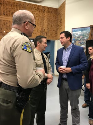 Tulare County Assistant Sheriff Robin Skiles, left, Sheriff Mike Boudreaux and Congressman Devin Nunes speak during a VIP breakfast at the World Ag Expo in Tulare.