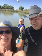 Cindy Davis and her husband, Mike Davis, enjoy a fishing trip with their grandson Brayden Leverett.