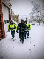 "Nutley Volunteer Emergency and Rescue Squad members, Treasurer Jonathan Arredondo, EMS Coordinator Emil Pugliese and EMS Capt. John P. Randall return to their headquarters on Chestnut Street, after helping move along a motorist whose car was stuck on Passaic Avenue. ""We are ready for a winter storm again,"" said Arredondo,."