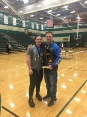 Croswell-Lexington powerlifter stands with his coach